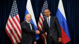 President Barack Obama, right, and Russia's President President Vladimir Putin shake hands before a bilateral meeting last week at United Nations headquarters. America's goal in Syria is more complicated than Russia's.