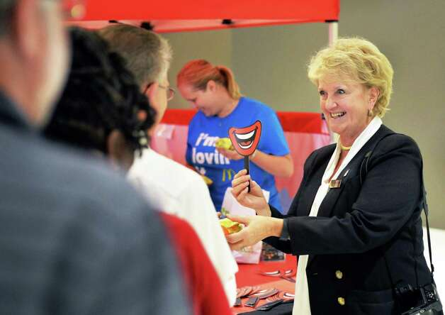 Kathie Reeher, owner of McDonalds at the Empire State Plaza hands out free Egg McMuffins during All Day Breakfast with Eggstravaganza at Empire State Plaza Tuesday Oct. 06, 2015 in Albany, NY.  (John Carl D'Annibale / Times Union) Photo: John Carl D'Annibale / 10033594A