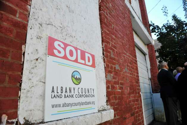 A sold sign is seen outside of 108 Broad St., on Tuesday, Oct. 6, 2015, in Albany, N.Y.   A press conference was held by the Albany County Land Bank on Tuesday to announce the sale of two properties in the South End to residents.  108 Broad St. and 63 Delaware St. are the two locations the Land Bank has sold.   (Paul Buckowski / Times Union) Photo: PAUL BUCKOWSKI / 10033633A