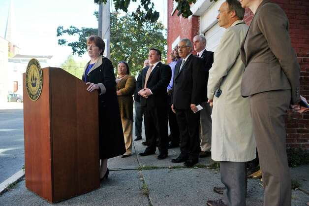 Albany Mayor Kathy Sheehan addresses those gathered for a press conference outside of 108 Broad St., on Tuesday, Oct. 6, 2015, in Albany, N.Y.  The press conference was held by the Albany County Land Bank to announce the sale of two properties in the South End to residents.  108 Broad St. and 63 Delaware St. are the two locations the Land Bank has sold.   (Paul Buckowski / Times Union) Photo: PAUL BUCKOWSKI / 10033633A
