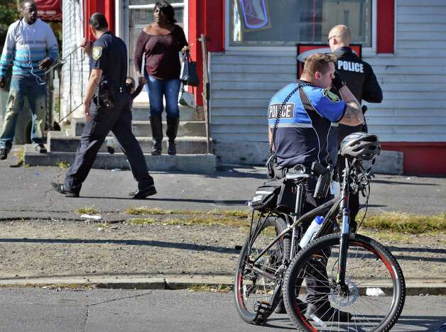 Police at the corner of Third and  Manning where a 16-year-old male was stabbed Tuesday Oct. 6, 2015 in Albany, NY. (John Carl D'Annibale / Times Union) Photo: John Carl D'Annibale