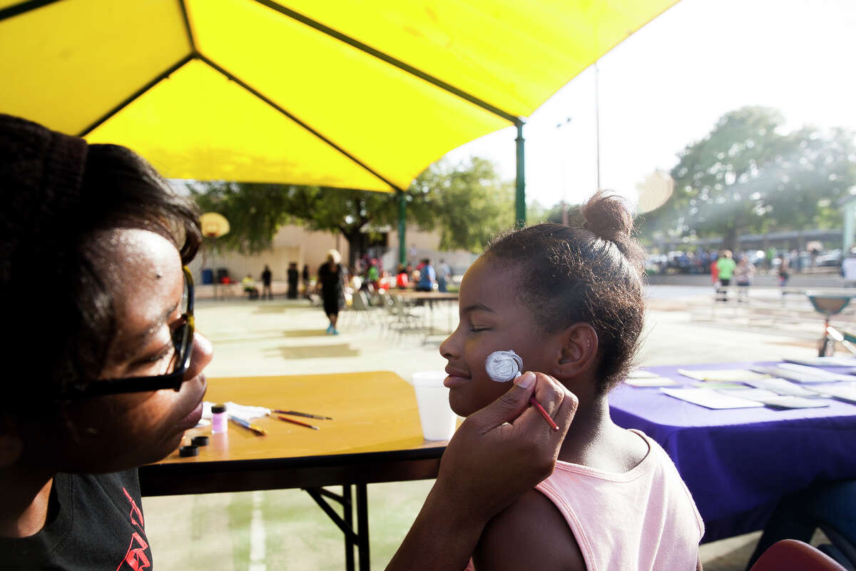Maleyiah Brown, 6, has her face painted Tuesday Oct. 6, 2015 during National Night Out at West End Hope in Action.