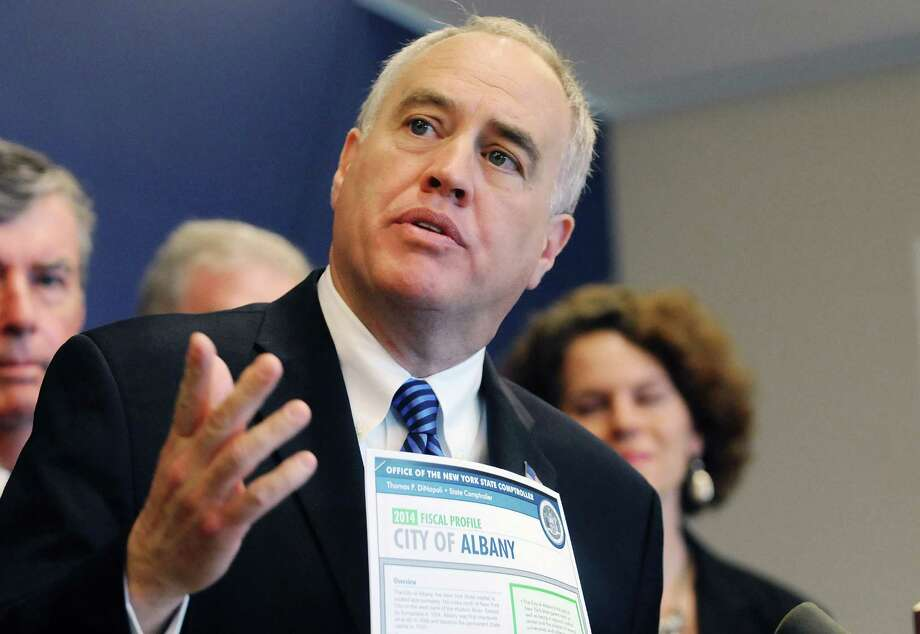 File - New York State Comptroller Thomas DiNapoli talks about the fiscal issues facing the city of Albany during a press conference at the State Comptroller's office on Tuesday, June 3, 2014, in Albany, N.Y.    (Paul Buckowski / Times Union archive) Photo: Paul Buckowski / 00027153A