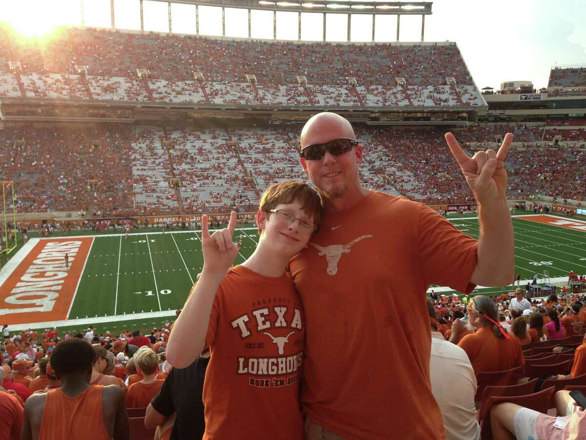 In the last photo David James has with his son, Peyton, before his suicide in October 2014, they attended a UT football game in Austin.