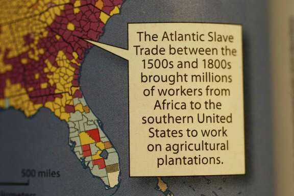 A caption about slaves in a geography textbook distributed to 400 school districts in Texas will be corrected by the publisher.
