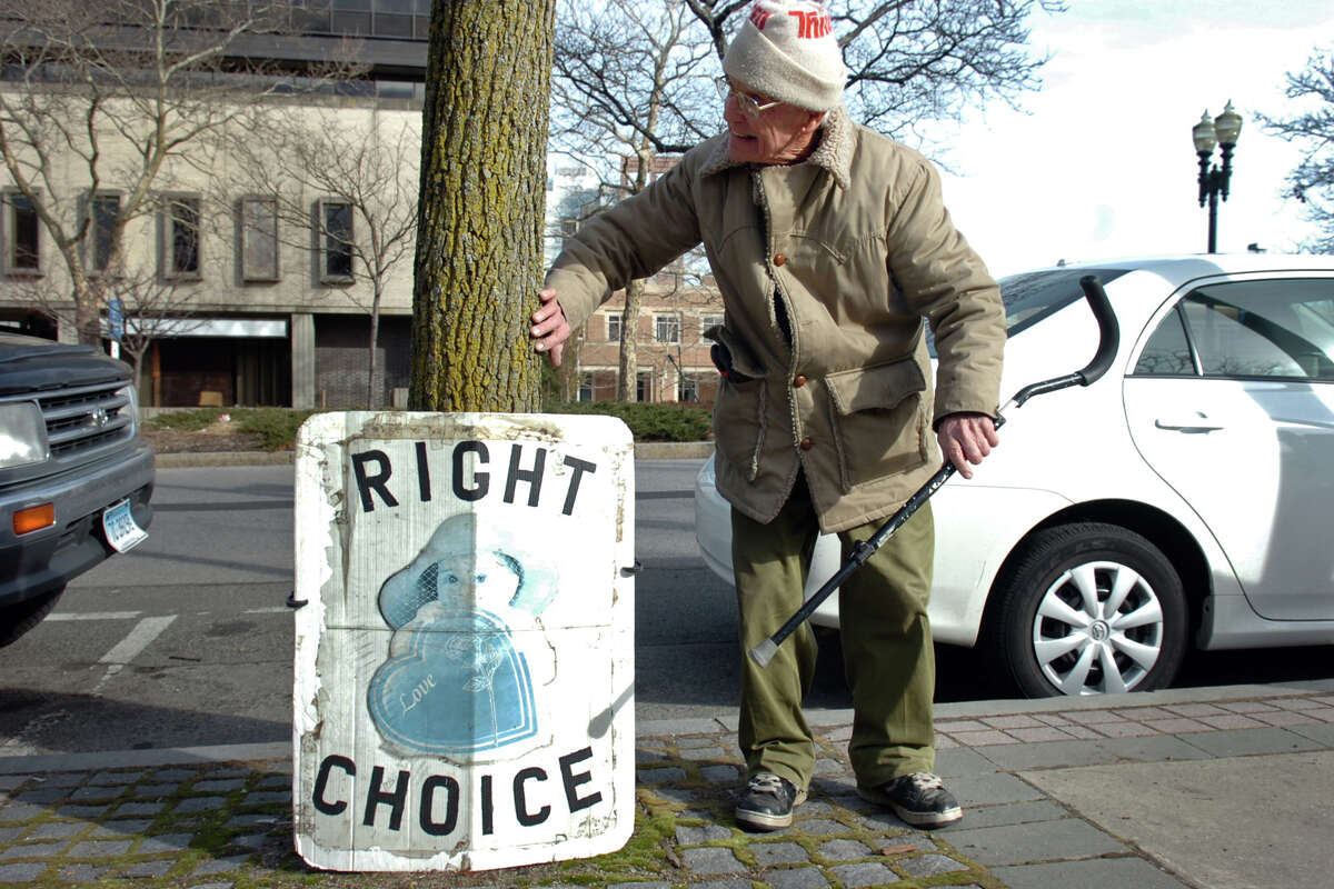 Stanley Scott, of Fairfield, heading a demonstration against the legalization of abortion outside the federal courthouse in Bridgeport in 2010.