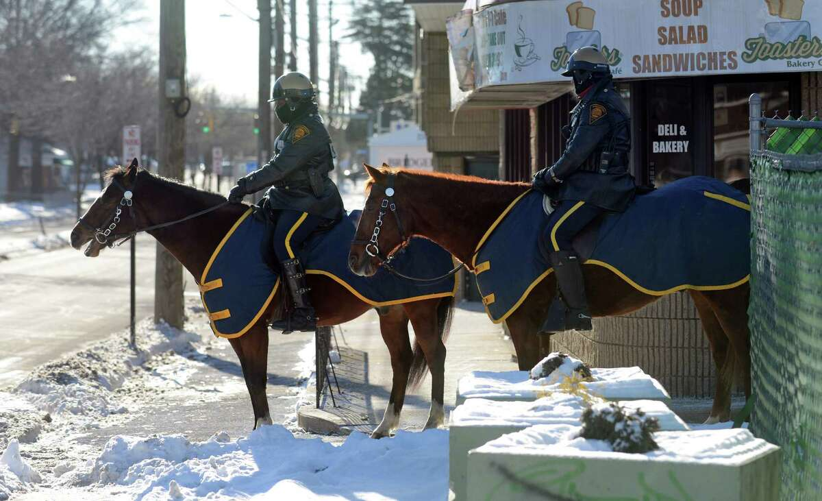 Mounted police officers stand by as Pro-life demonstrators hold a memorial prayer vigil marking the anniversary of Roe v. Wade, the U.S. Supreme Court ruling that legalized access to abortion, in 2014 outside the Summit Women's Center.