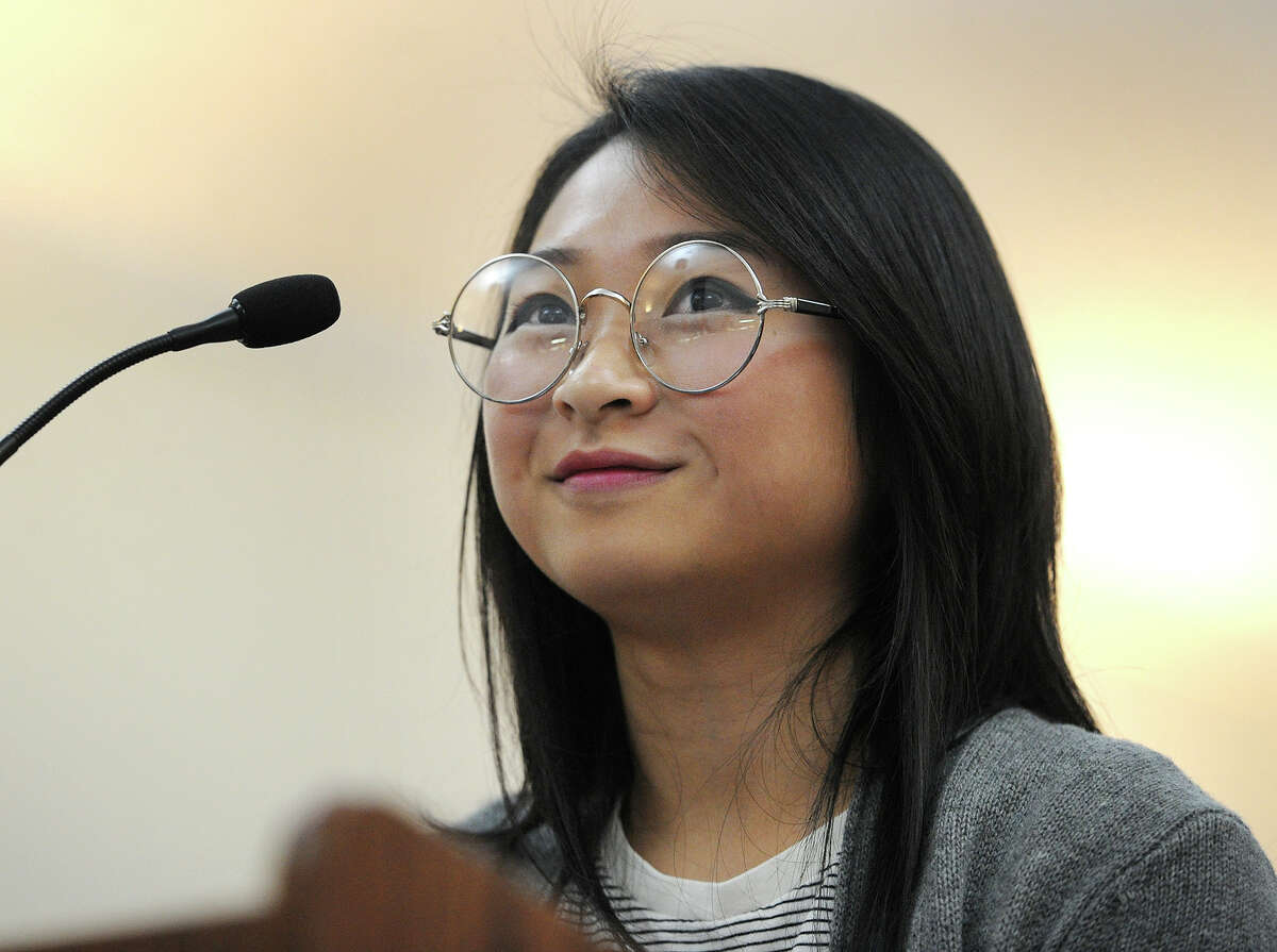 Trumbull High School senior Julie Trinh addresses the Trumbull Board of Education in support of fired substitute teacher Joseph Rodgers on Tuesday.