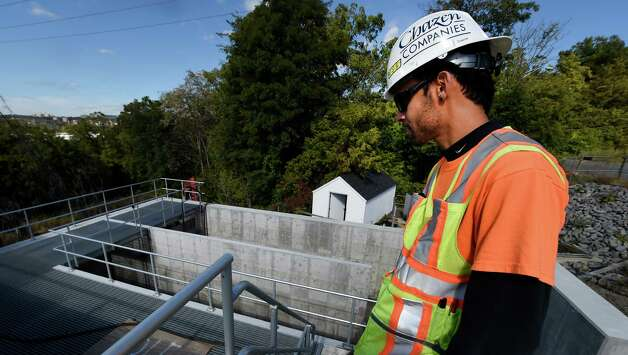 Project engineer Edwin Droz looks over the chlorine contact tank which was undermined by recent heavy rains at the East Greenbush Water Treatment Plant Tuesday afternoon Oct. 6, 2015 in East Greenbush, N.Y.      (Skip Dickstein/Times Union) Photo: SKIP DICKSTEIN / 10033638A