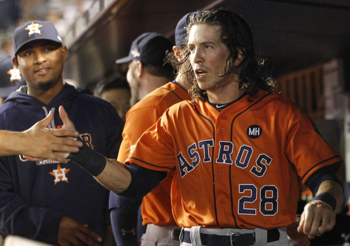 Astros outfielder Colby Rasmus (28) is helping his younger teammates dress for success this season.