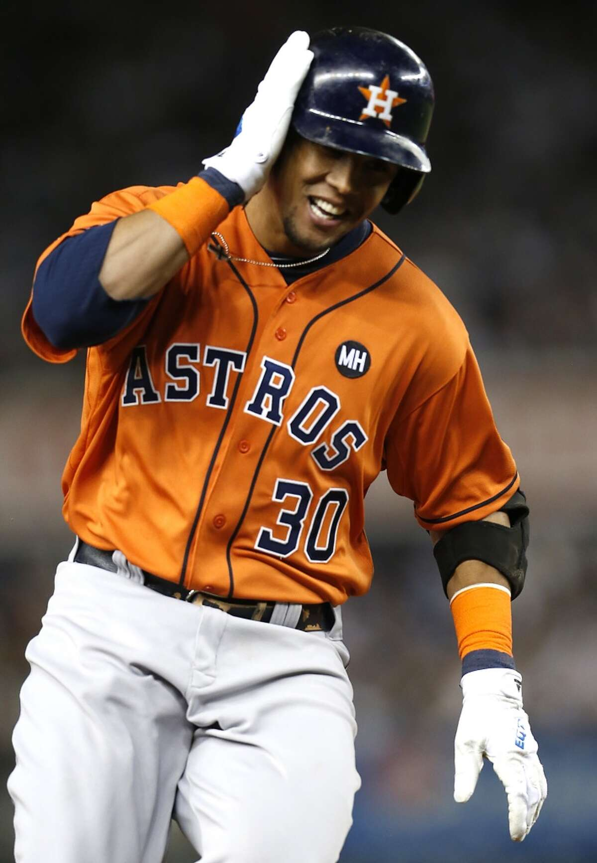 Houston Astros center fielder Carlos Gomez (30) rounds the bases after hitting a solo home run off New York Yankees starting pitcher Masahiro Tanaka during fourth inning of the American League Wild Card game at Yankee Stadium on Tuesday, Oct. 6, 2015, in New York. ( Karen Warren / Houston Chronicle )