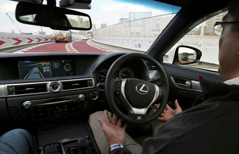 A Toyota employee takes a Lexus GS automated-driving test vehicle for a spin on Tuesday in Tokyo. Photo: Koji Sasahara, STF / AP