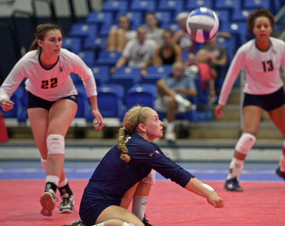 FILE PHOTO: Western's Jenna Skerritt (5) digs out a serve during a women's college volleyball game between Western New England and Western Connecticut State University. Played at WCSU Westside Campus, on Thursday, September 3, 2015, in Danbury, Conn. Western's Cady Cordes (22) and Karissa Smith (13) look on. Photo: H John Voorhees III / Hearst Connecticut Media / The News-Times