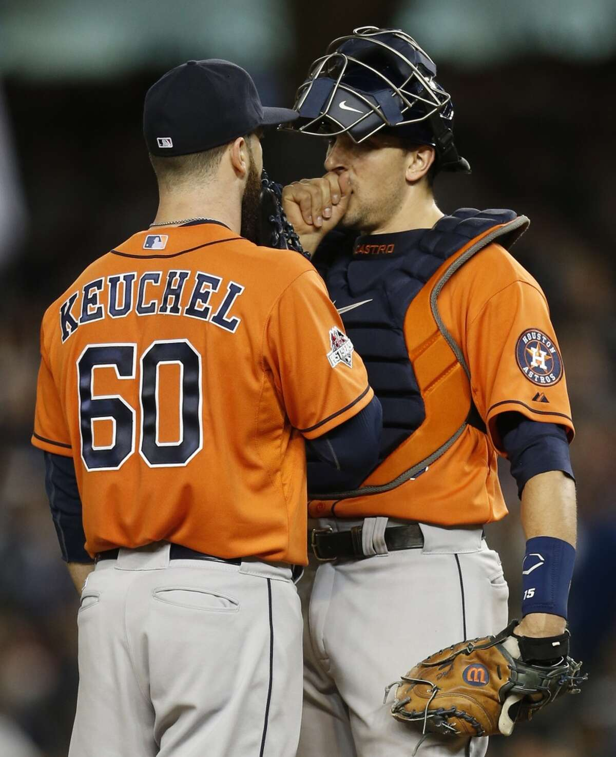 Houston Astros starting pitcher Dallas Keuchel (60) talks to catcher Jason Castro during sixth inning of the American League Wild Card game against the New York Yankees at Yankee Stadium on Tuesday, Oct. 6, 2015, in New York. ( Karen Warren / Houston Chronicle )