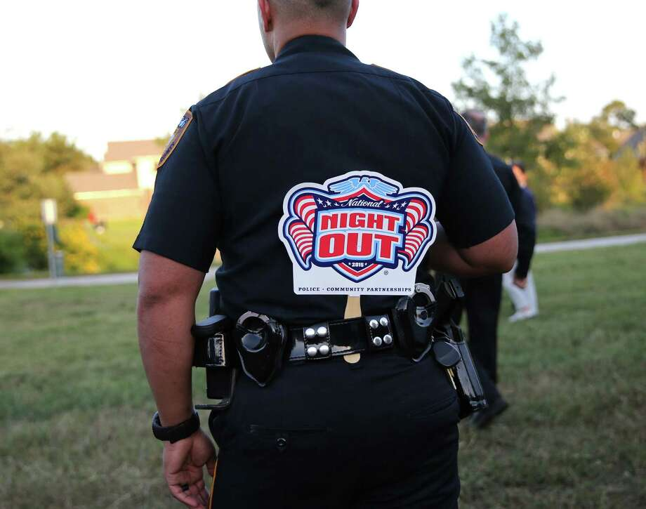Deputy Jammin Smith find observes the National Night Out celebration. Photos of National Night Out in Harris County in Houston on Tuesday, Oct. 6, 2015, in Houston. Long with traditional outside lights and front porch vigils, one community will be celebrating the special dedication of a living memorial to fallen Harris County Sheriff's Deputy Darren Goforth. Photo: Elizabeth Conley, Houston Chronicle / © 2015 Houston Chronicle
