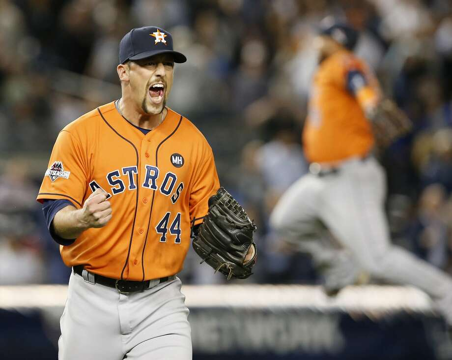 Houston Astros relief pitcher Luke Gregerson (44) reacts as a fellow teammate leaps in the air at the final out of the Astros 3-0 shutout of the New York Yankees in the American League wild card baseball game at Yankee Stadium in New York, Tuesday, Oct. 6, 2015.  (AP Photo/Kathy Willens) Photo: Kathy Willens, Associated Press