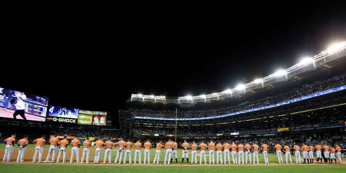The Astros line the third-base chalk during introductions before their American League wild-card victory over New York at Yankee Stadium on Tuesday night.