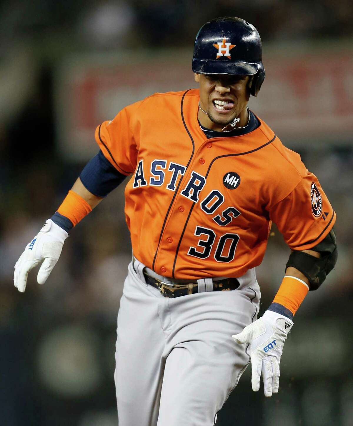 Carlos Gomez enjoys a happy romp around the bases after the Astros' center fielder slugged a solo home run in the fourth inning Tuesday night.