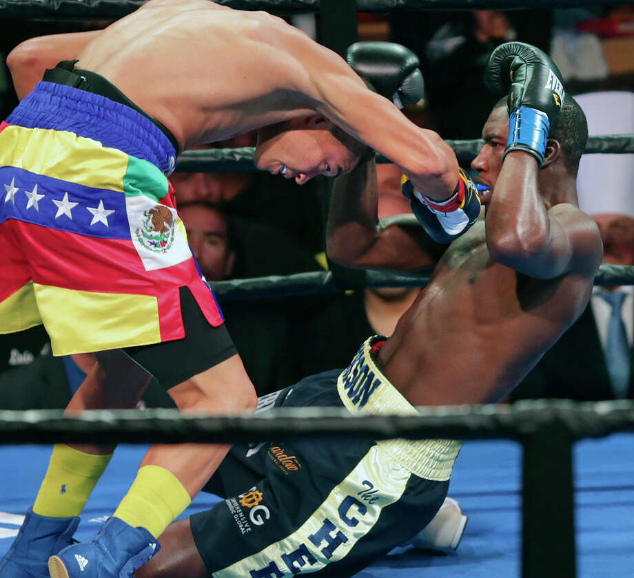 Jose Uzcategui  takes Julius Jackson to the canvas in the first round on the way to victory in the  main event of Premier Boxing Champions boxing card at Cowboys Dance Hall  on October 6, 2015. Photo: Tom Reel / San Antonio Express-News