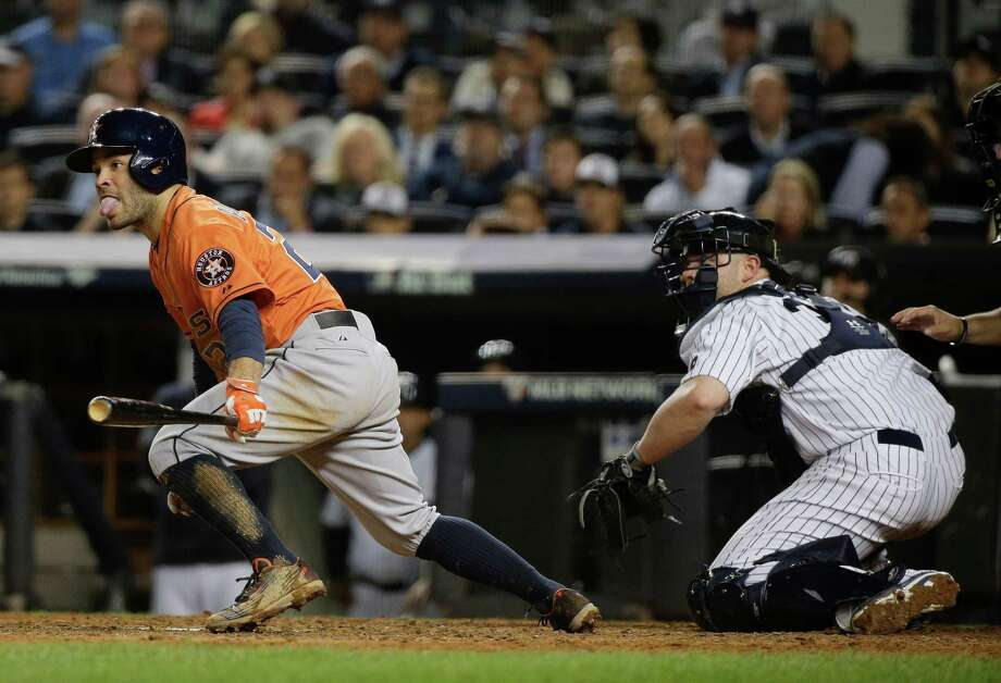 Houston Astros' Jose Altuve breaks out of the batters box upon hitting an RBI base hit as New York Yankees catcher Brian McCann looks on during the seventh inning of the American League wild card baseball game, Tuesday, Oct. 6, 2015, in New York. Jonathan Villar scored from second base on the play. (AP Photo/Julie Jacobson)  ORG XMIT: NYY223 Photo: Julie Jacobson / AP