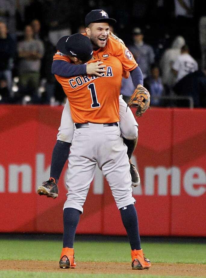 Astros second baseman Jose Altuve and shortstop Carlos Correa delight in Tuesday night's victory. Photo: Karen Warren, Staff / © 2015 Houston Chronicle