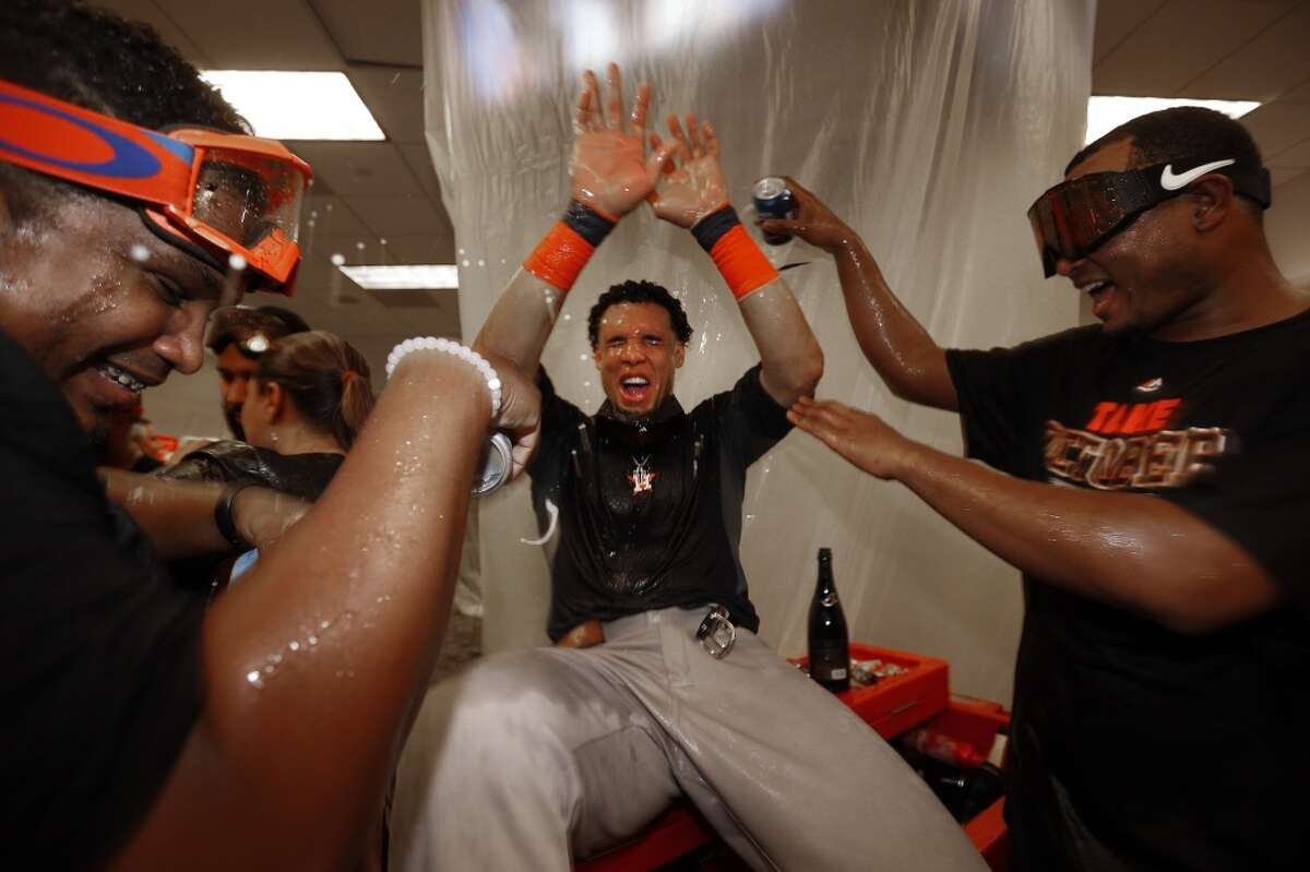 Houston Astros center fielder Carlos Gomez (30) gets beer poured on him as the team celebrated the American League Wild Card game at Yankee Stadium on Tuesday, Oct. 6, 2015, in New York. ( Karen Warren / Houston Chronicle )