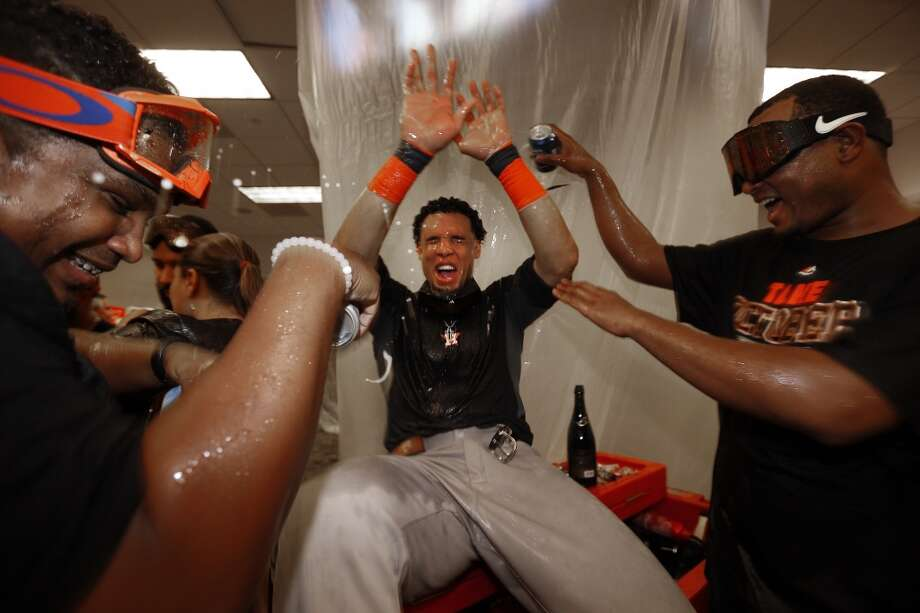 Houston Astros center fielder Carlos Gomez (30) gets beer poured on him as the team celebrated the American League Wild Card game at Yankee Stadium on Tuesday, Oct. 6, 2015, in New York. ( Karen Warren / Houston Chronicle ) Photo: Houston Chronicle