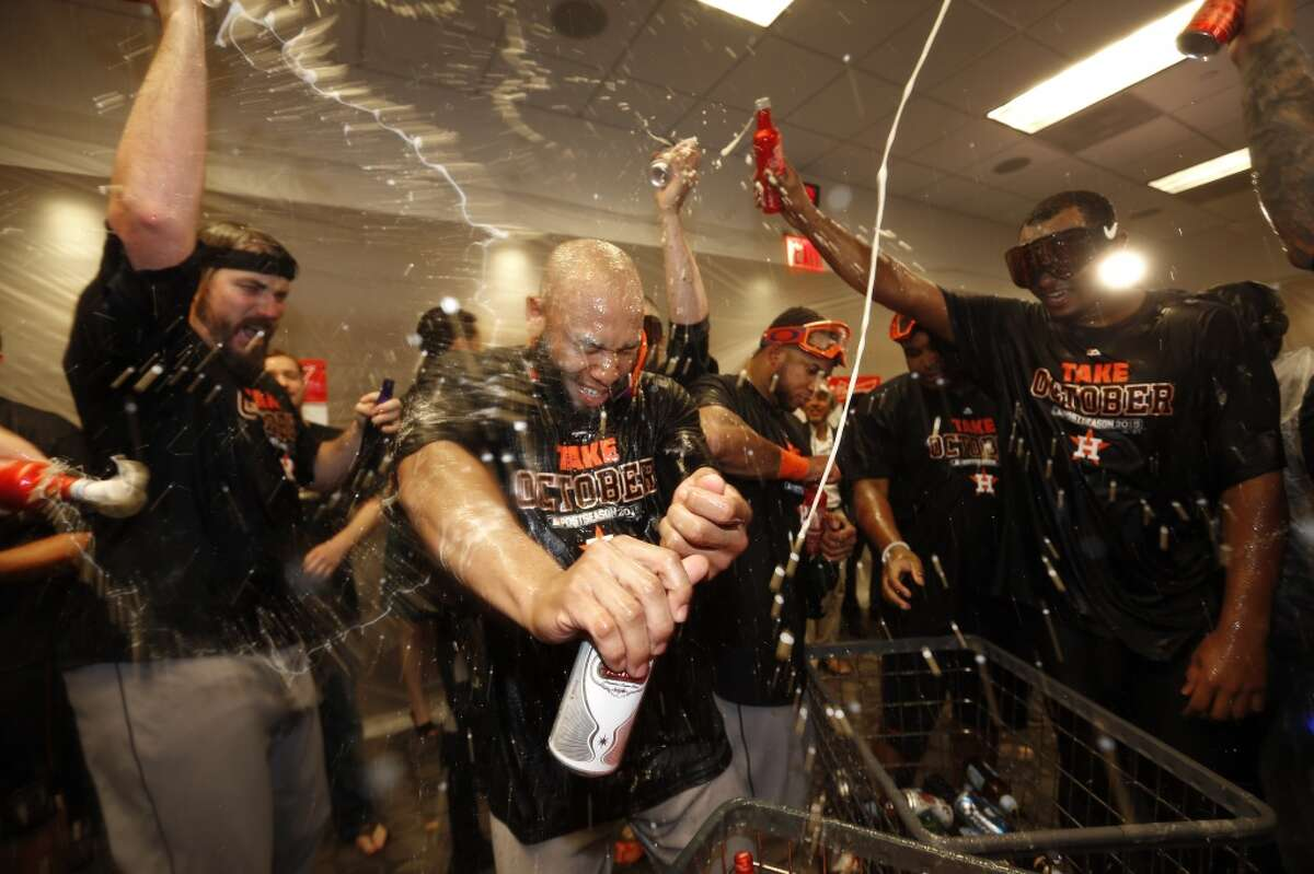 Houston Astros designated hitter Jon Singleton gets beer poured on him by teammates as they celebrate after winning the American League Wild Card game at Yankee Stadium on Tuesday, Oct. 6, 2015, in New York. ( Karen Warren / Houston Chronicle )