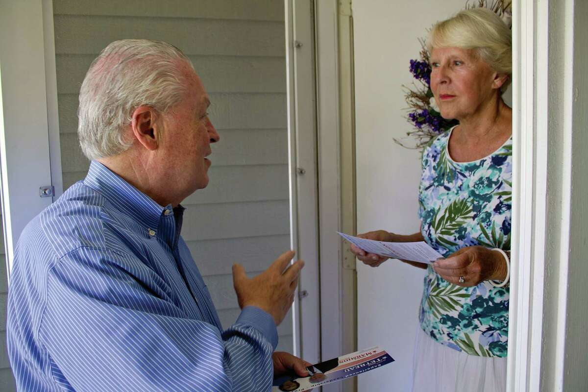 First Selectman Mike Tetreau talks with a resident while campaigning for re-election to a second term.