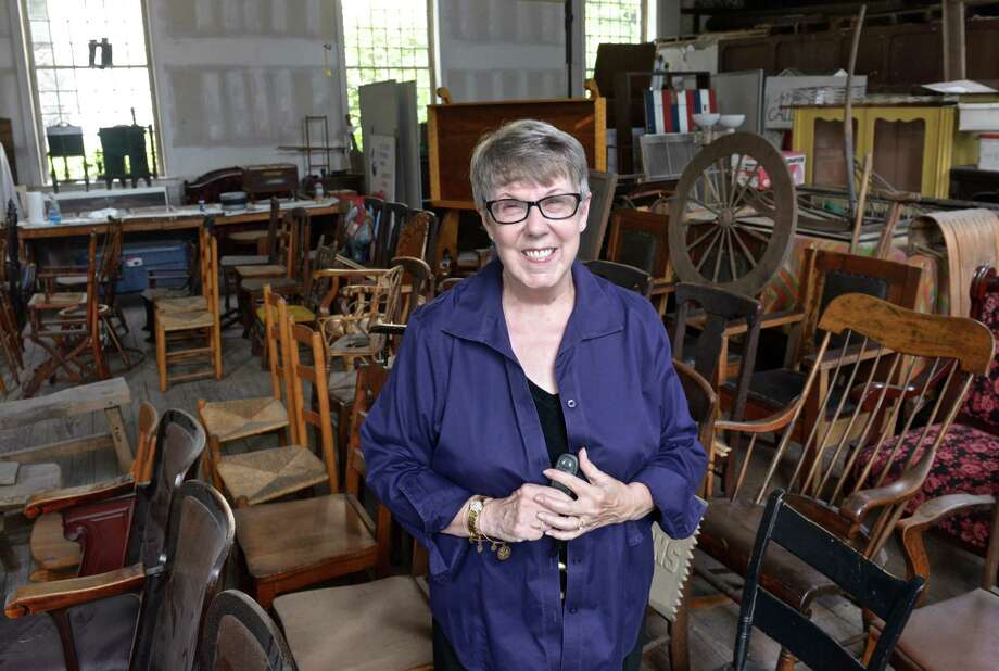 Pat Rist, president of the Bethel Historical Society, stands in a furniture storage area of the building on Main Street on Thursday, Sept. 3, 2015, in Bethel, Conn. Photo: H John Voorhees III / File Photo / The News-Times