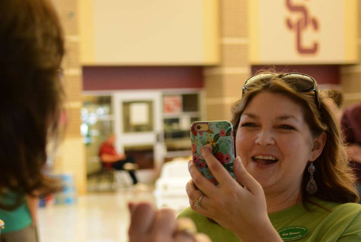 Quest Early College High School curriculum facilitator Kimberly Mouser records a moment at the