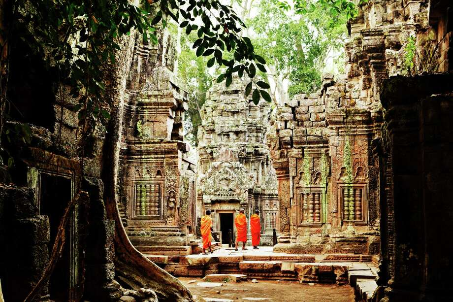 "TOP 25 PLACES TO SEE AROUND THE WORLD, ACCORDING TO LONELY PLANET'S 'ULTIMATE TRAVEL'1. Temples of Angkor, CambodiaWhy: ""Angkor Wat is the crowning glory in a complex of more than 1,000 temples, shrines and tombs that forms a virtual city of spires in the jungles of northern Cambodia. ... Every visitor who steps among the ruins, where tree roots tear through ancient walls and the heads of forgotten deities poke out between the vines, feels like Indiana Jones."" Photo: Mark Read, Mark Read / Lonely Planet / © Lonely Planet Global Inc, All Rights Reserved."