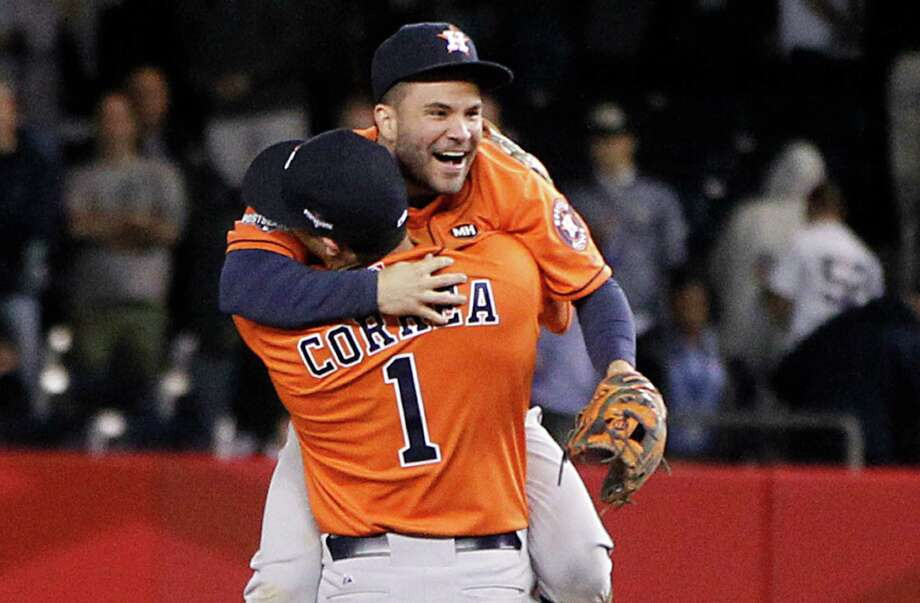 Astros second baseman Jose Altuve and shortstop Carlos Correa embrace after the final out of their shutout victory over the Yankees. It was Houston's first playoff game since 2005. Photo: Karen Warren / Houston Chronicle / © 2015 Houston Chronicle