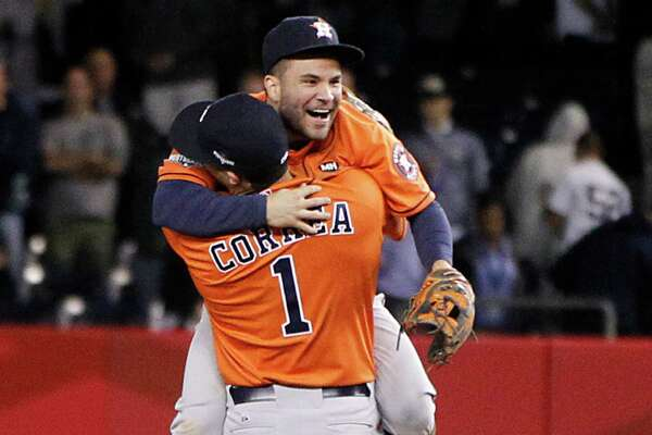 Astros second baseman Jose Altuve and shortstop Carlos Correa embrace after the final out of their shutout victory over the Yankees. It was Houston's first playoff game since 2005.