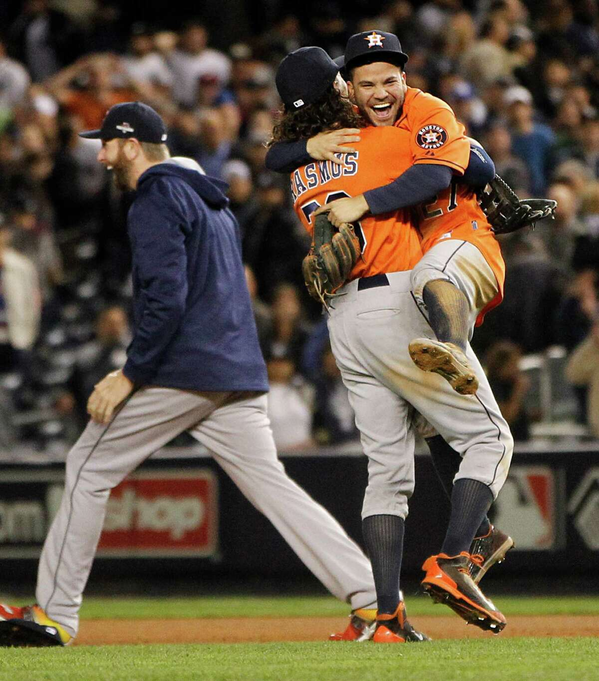 Houston Astros second baseman Jose Altuve (27) and Houston Astros left fielder Colby Rasmus (28) celebrate the Astros 3-0 win over the New York Yankees in the American League Wild Card game at Yankee Stadium on Tuesday, Oct. 6, 2015, in New York. ( Karen Warren / Houston Chronicle )