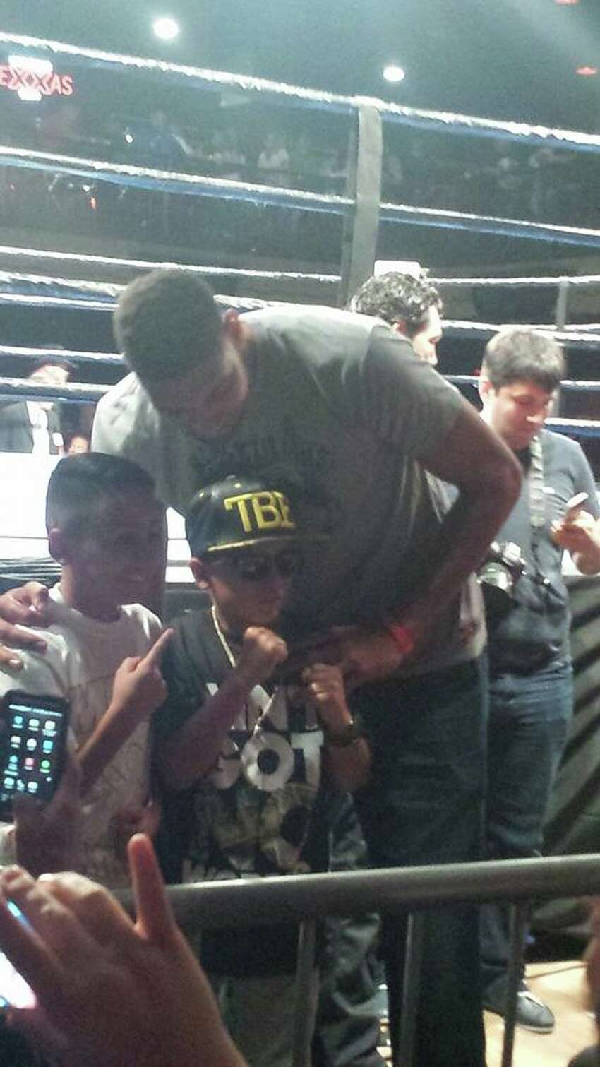 He did take time to pose for photos with young fans who were sitting near the ring, Vega-Hale said.