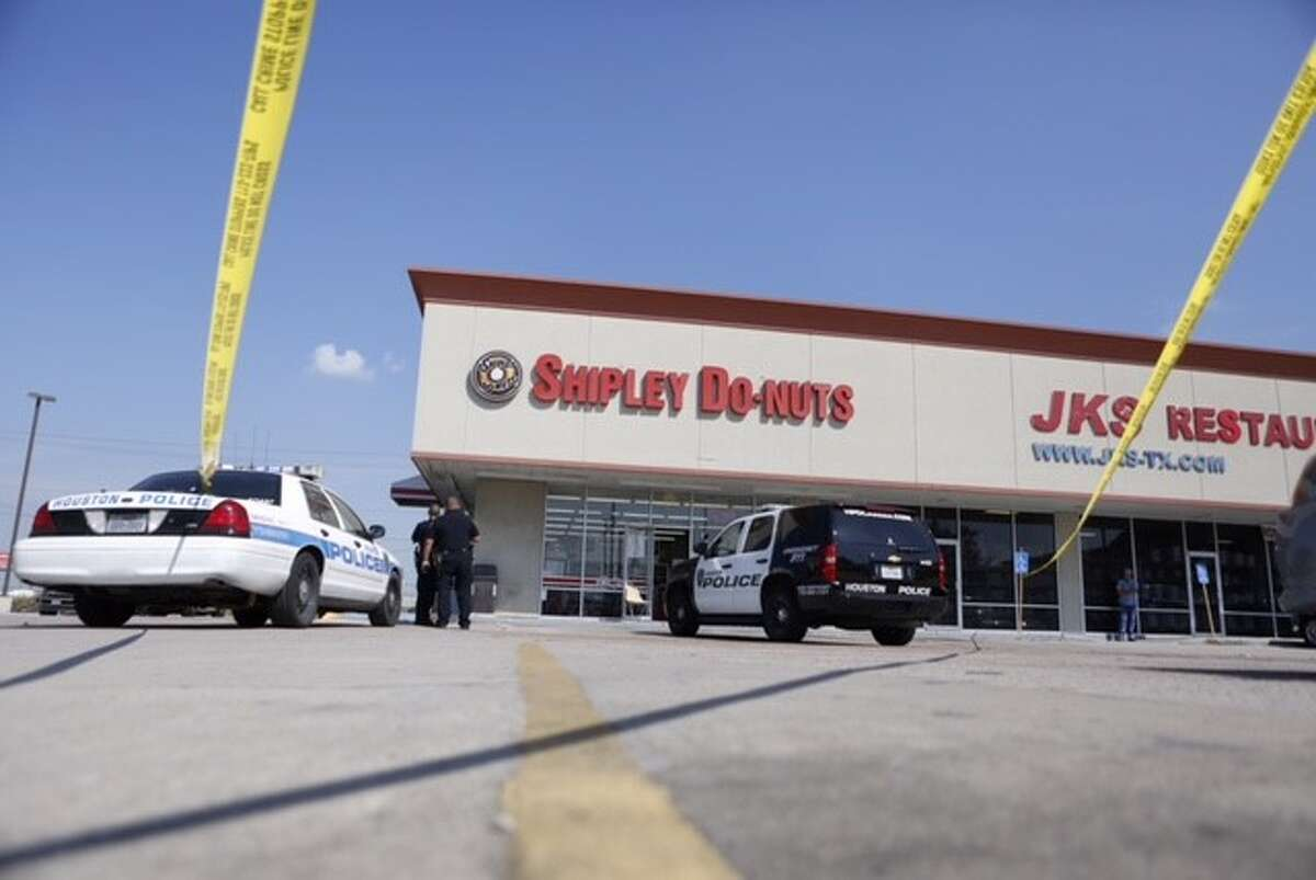 Police investigate the scene of a robbery at a Houston-area Shipley Do-Nuts store on Oct. 7, 2015.