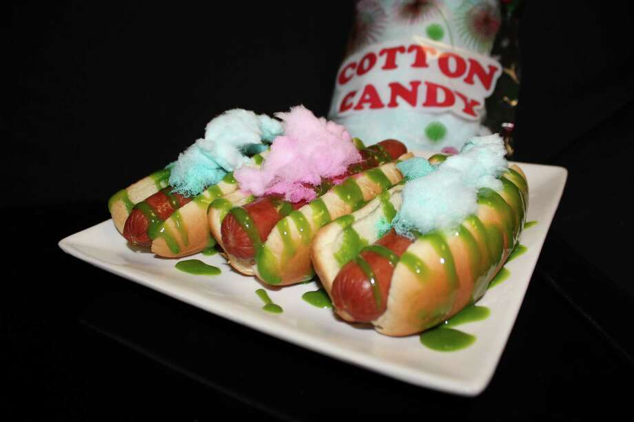 The Sweet Spot Cotton Candy Dog - $10 An all-beef hot dog with cotton candy-infused mustard.  It is then topped with just enough cotton candy to make it both sweet and salty. Photo: Jon Ziskal Of Delaware North Sportservice