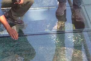Glass walkway shatters above abyss, terrifying tourists - Photo