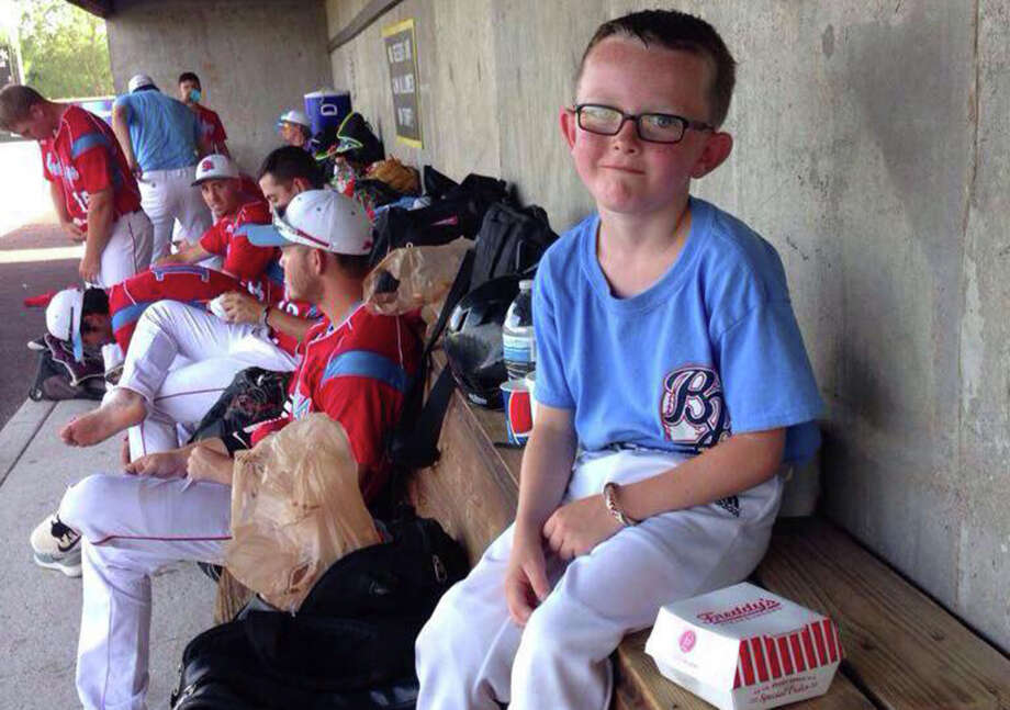 Batboy Kaiser Carlile, 9, was remembered for his love of the game during his memorial service on Aug. 4, 2015. Carlile died when he was accidentally hit by a bat during a game. Photo: Courtesy Photo / Liberal Bee Jays / THE WASHINGTON POST