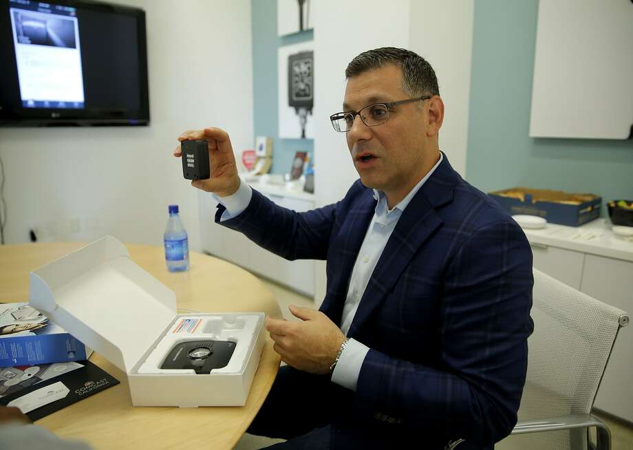 Daniel Herscovici explains a garage door security system integrated into the Xfinity Home App at the Comcast offices in San Francisco, California, on Wednesday, Oct. 7, 2015. Photo: Connor Radnovich, The Chronicle