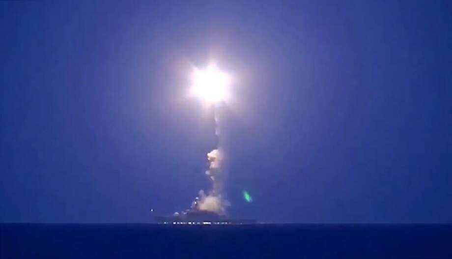 Russian warships in the Caspian Sea fires cruise missiles against Islamic State targets in Syria, some 930 miles away. Photo: Tass, McClatchy-Tribune News Service