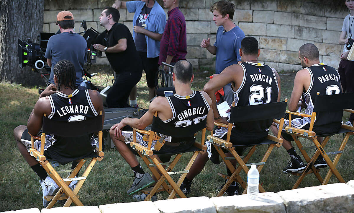 San Antonio Spurs Kawhi Leonard, from left, Manu Ginobili, Tim Duncan and Tony Parker wait for the film crew to set up as members of the team spent much of the afternoon at their practice facility performing for new H-E-B commercials on Tuesday, October 6, 2015, that will be aired during the upcoming season.