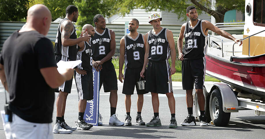 San Antonio Spurs LaMarcus Aldridge, from left, Patty Mills, Kawhi Leonard, Tony Parker, Manu Ginobili, and Tim Duncan run through a scene for new HEB commercials on Tuesday, October 6, 2015, that will be aired during the upcoming season. Photo: Bob Owen, Staff / San Antonio Express-News / ©2015 San Antonio Express-News