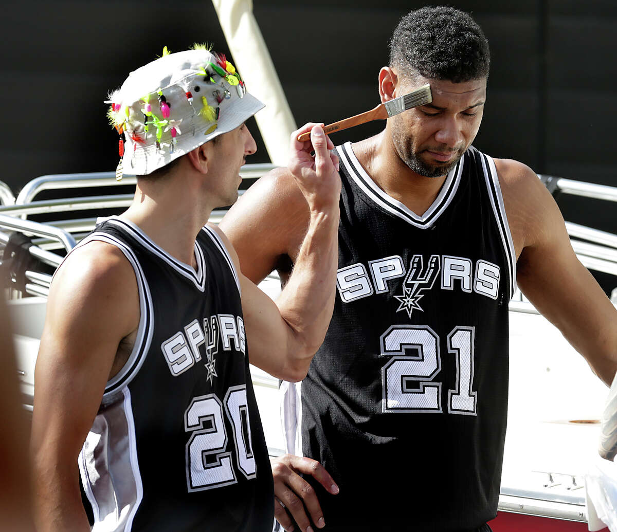 Manu Ginobili, left, pretends to apply makeup to teammate Tim Duncan as the San Antonio Spurs spent much of the afternoon Tuesday, October 6, 2015, at their practice facility performing for new H-E-B commercials that will be aired during the upcoming season.
