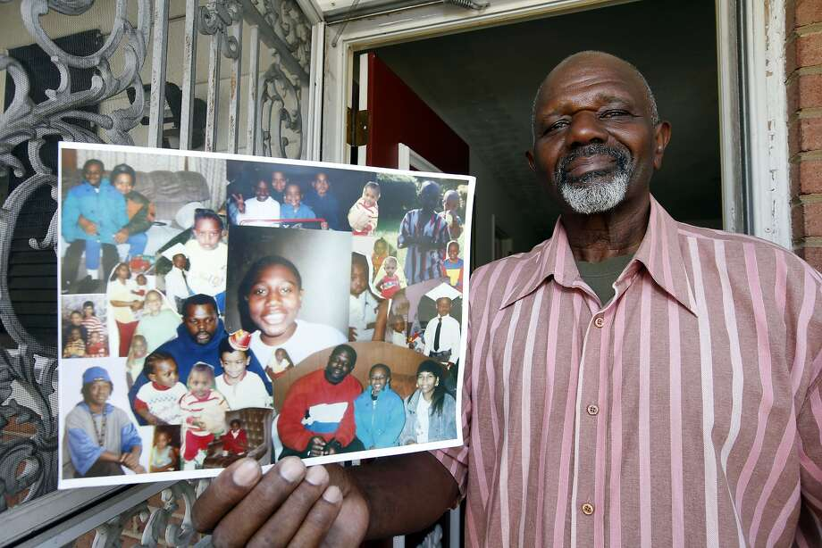Maryland resident Kenneth Evans holds photos of his son Tuan, who is scheduled for early release. Photo: Alex Brandon, Associated Press