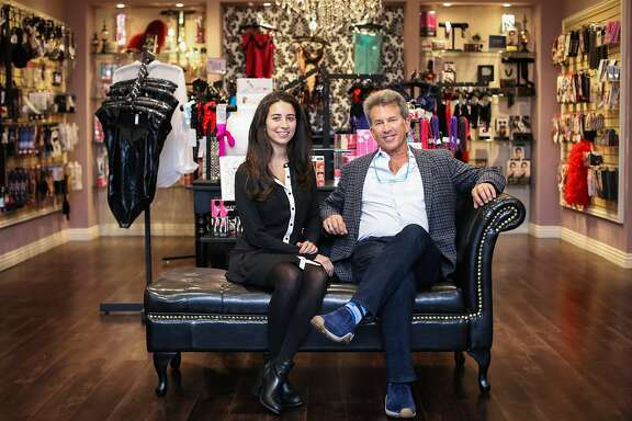 Jeffrey Hollender (right), and his daughter, Meika Hollender (left), who own a sexual wellness brand, Sustain, pose for a portrait inside Good Vibrations in San Francisco, California on September 28, 2015. Sustain creates sustainable, non-toxic, Fair Trade certified condoms and water-based, all-natural, organic personal lubricants. Sustain launched their new towelettes to help with post-encounter, afterglow hygiene.