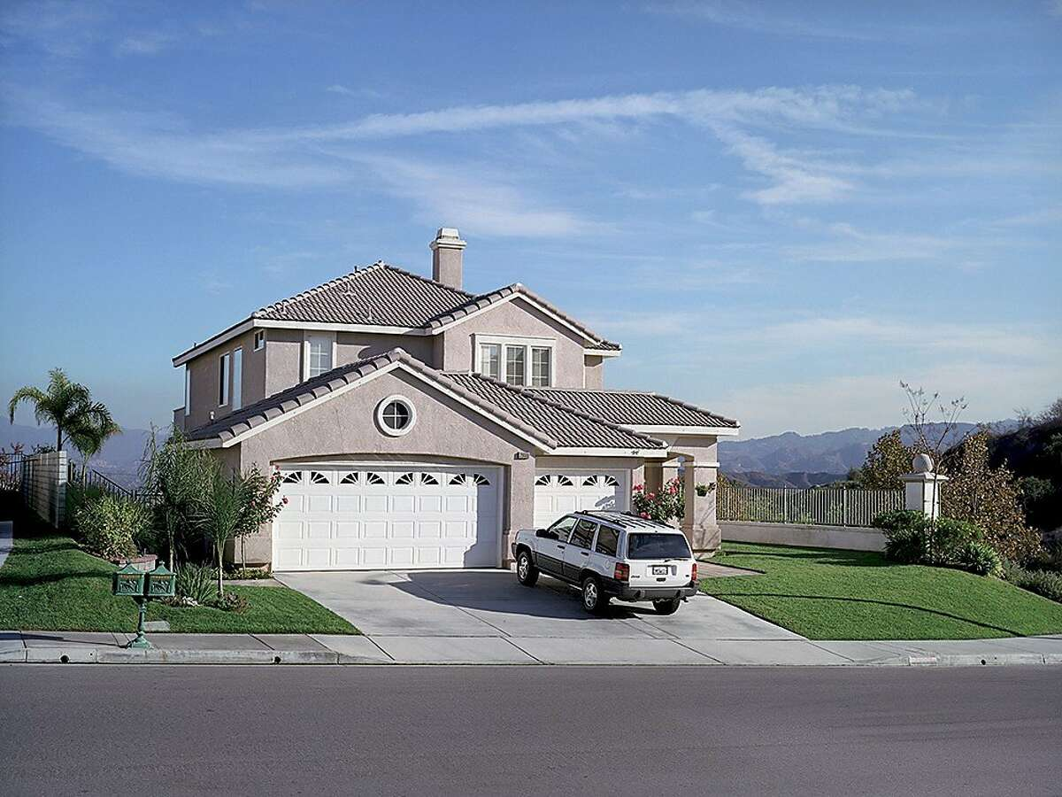 White SUV outside new house, California - from the series American Night, 2002.