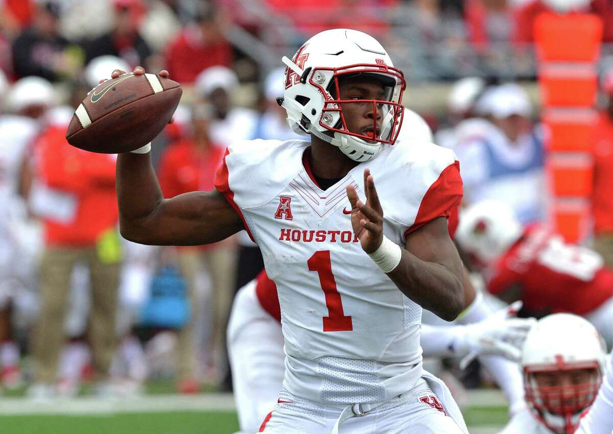 Houstin's Greg Ward Jr. (1) attempts a pass during the second half of an NCAA college football game in Louisville, Ky. Saturday, Sept. 12, 2015. Houston defeated Louisville 34-31. (AP Photo/Timothy D. Easley)