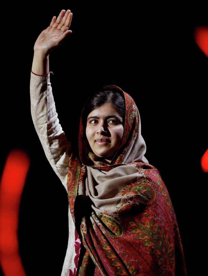 Joint-Nobel Peace Prize winner Malala Yousafzai from Pakistan waves as she arrives to speak on stage during the Nobel Peace Prize Concert in Oslo, Norway, Thursday, Dec. 11, 2014.  Malala Yousafzai from Pakistan and Kailash Satyarthi of India received the Nobel Peace Prize on Wednesday for risking their lives to help protect children from slavery, extremism and forced labor at great risk to their own lives.  (AP Photo/Matt Dunham) ORG XMIT: LMD127 Photo: Matt Dunham / AP